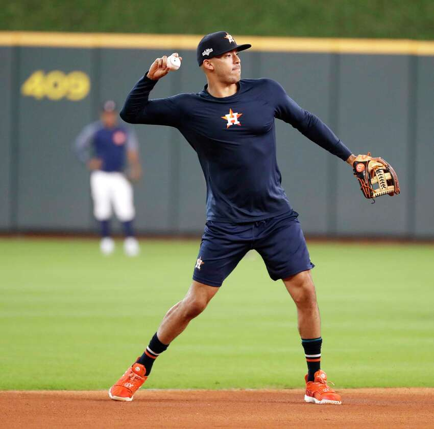 Houston Astros Carlos Correa fields ground balls during optional workouts at Minute Maid Park, Wednesday, Oct. 9, 2019, in Houston.