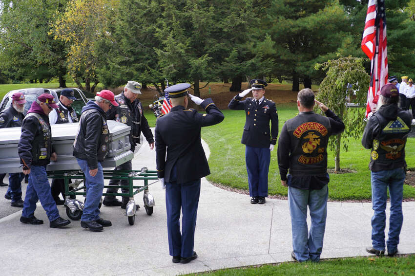 Members of the Patriot Guard Riders carry the casket of veteran Ambrose Jacob during his funeral service at the Gerald B.H. Solomon Saratoga National Cemetery on Wednesday, October 9, 2019, in Schuylerville, N.Y. (Paul Buckowski/Times Union)