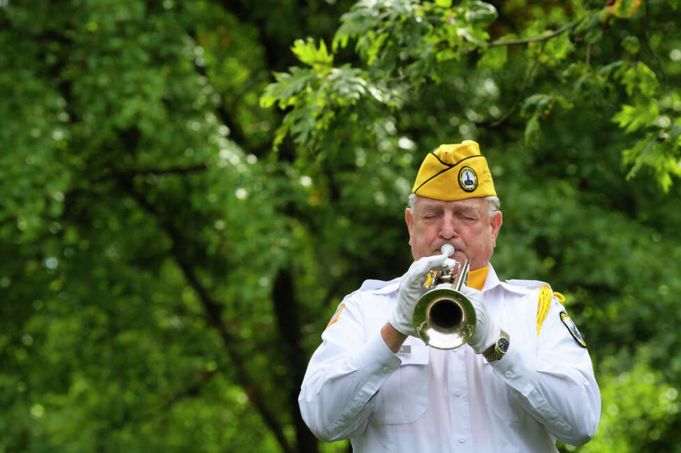 Air Force veteran Norm Miller, a member of the Saratoga National Cemetery honor guard, plays taps during the funeral for veteran Ambrose Jacob the Gerald B.H. Solomon Saratoga National Cemetery on Wednesday, October 9, 2019, in Schuylerville, N.Y. (Paul Buckowski/Times Union)