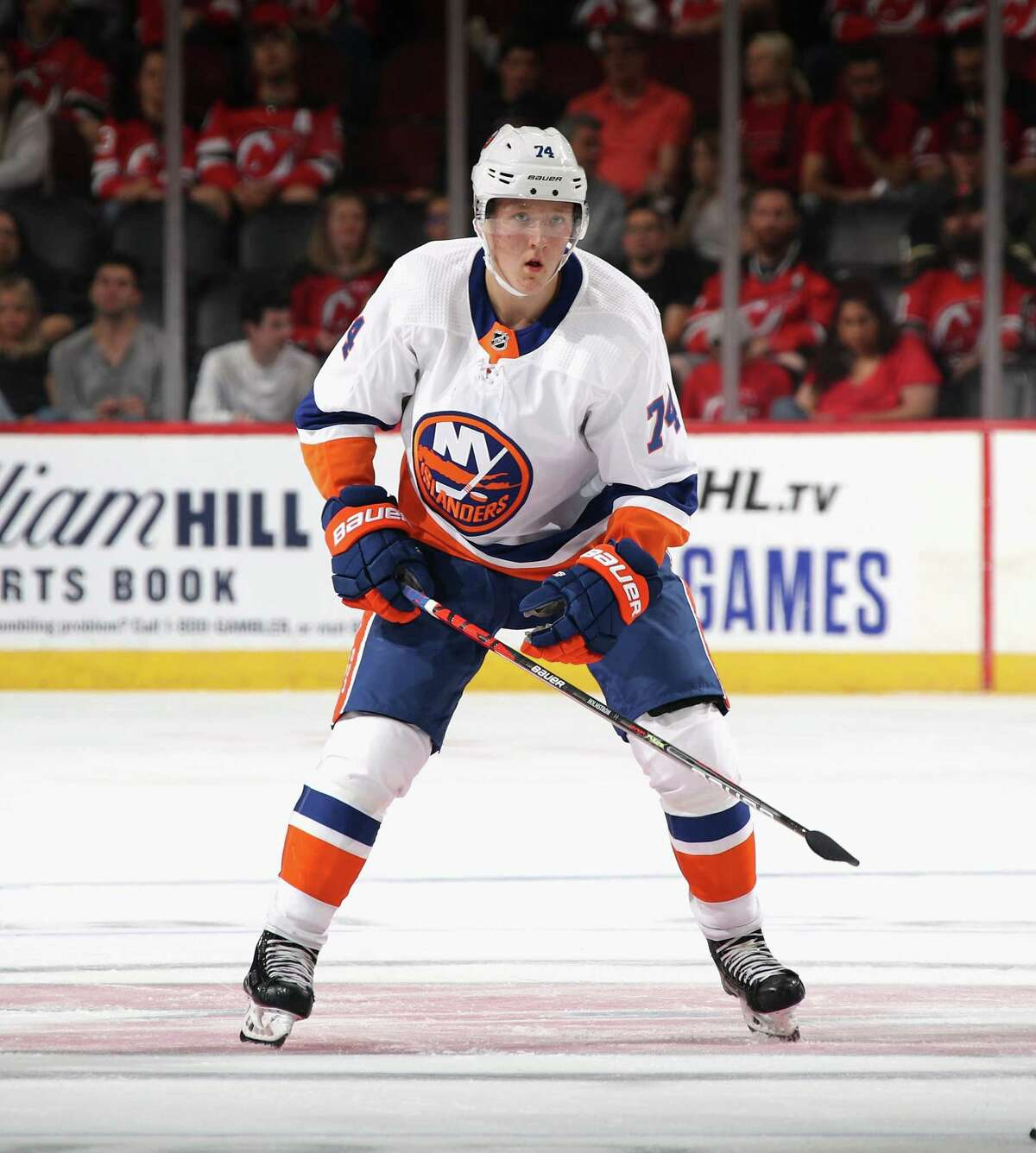 NEWARK, NEW JERSEY - SEPTEMBER 21: Simon Holmstrom #74 of the New York Islanders skates against the New Jersey Devils at the Prudential Center on September 21, 2019 in Newark, New Jersey. The Devils defeated the Islanders 4-3. (Photo by Bruce Bennett/Getty Images)