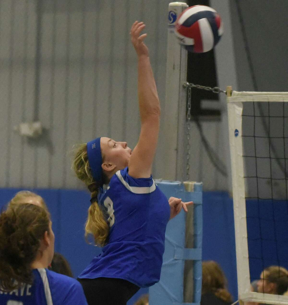 Darien's Elaina Cummiskey sends the ball back over the net during the CIAC's Early Season Block Party tournament at the CT Sports Center in Woodbridge.