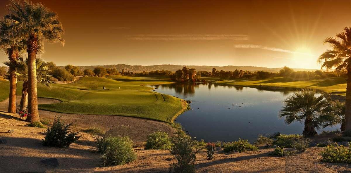 The hot morning sun comes up over a desert golf course in Palm Desert California.