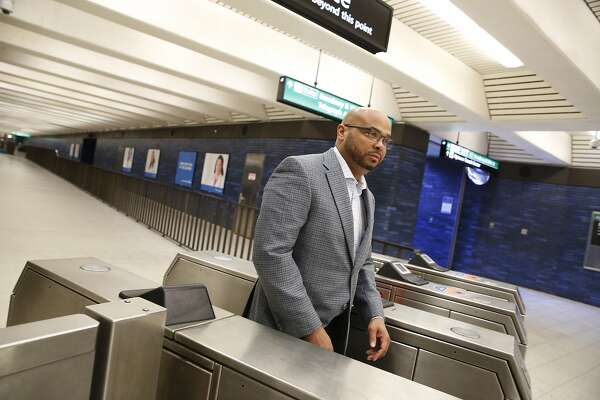 BART's deputy general manager Michael Jones walks through a turnstile after riding a BART train on Monday October 7, 2019 in Oakland, Calif.