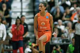 Connecticut Sun's Jasmine Thomas celebrates after sinking a shot during the second half in Game 4 of basketball's WNBA Finals against the Washington Mystics, Tuesday, Oct. 8, 2019, in Uncasville, Conn. (AP Photo/Jessica Hill)
