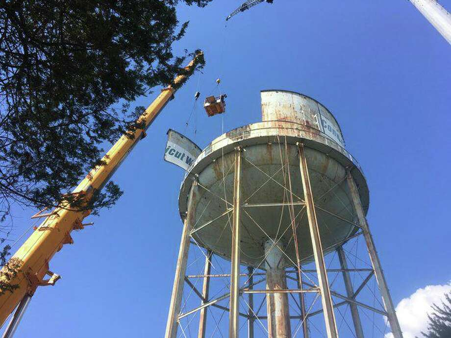 An obsolete Connecticut Water tank is dismantled in 2018 in Westbrook, Conn. On Oct. 9, 2019, SJW Group completed its acquisition of Connecticut Water and subsidiary Maine Water. (file photo via Connecticut Water and Twitter)