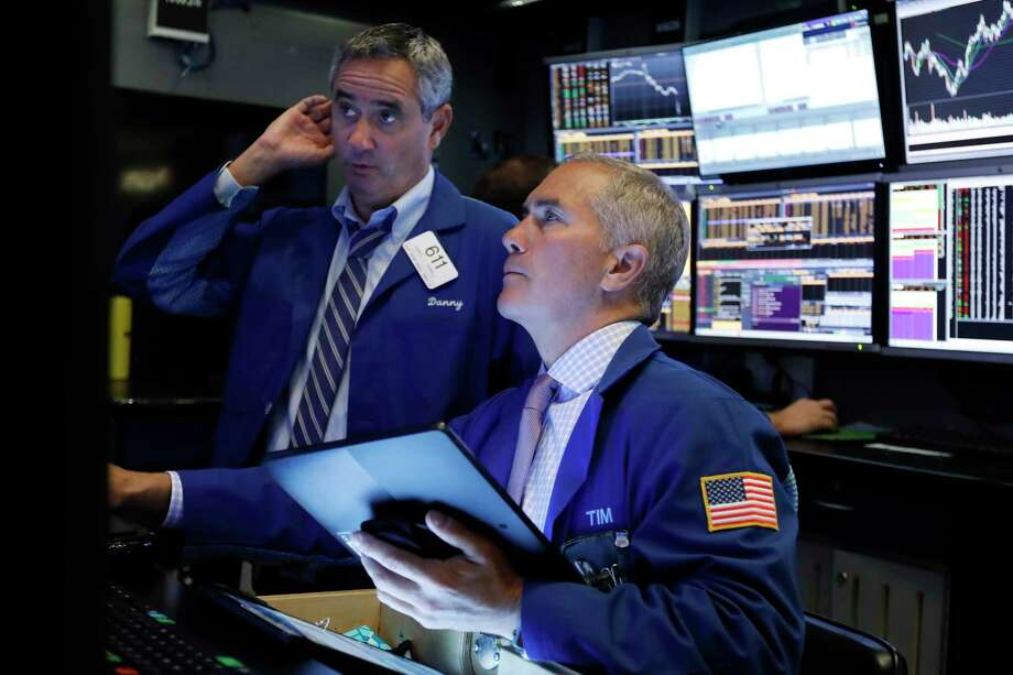 FILE - In this Oct. 2, 2019, file photo traders Daniel Trimble, left, and Timothy Nick work on the floor of the New York Stock Exchange. The U.S. stock market opens at 9:30 a.m. EDT on Wednesday, Oct. 9. (AP Photo/Richard Drew, File) Photo: Richard Drew / Copyright 2019 The Associated Press. All rights reserved