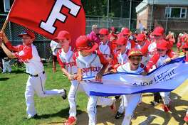 Fairfield American celebrates its win over Westport during District 2 little league baseball championship action at Unity Field in Trumbull, Conn., on Saturday July 13, 2019.