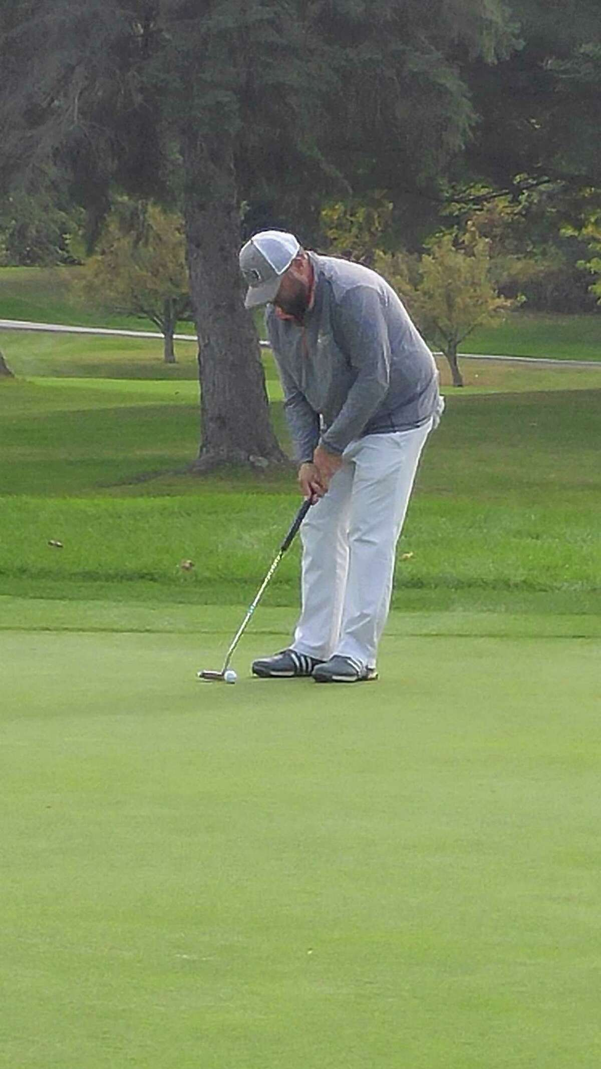 Scott Berliner of Hiland attempts a birdie putt Wednesday, Oct. 9, 2019, during the Northeastern New York PGA Tour Championship at the Albany Country Club. (Pete Dougherty / Times Union)