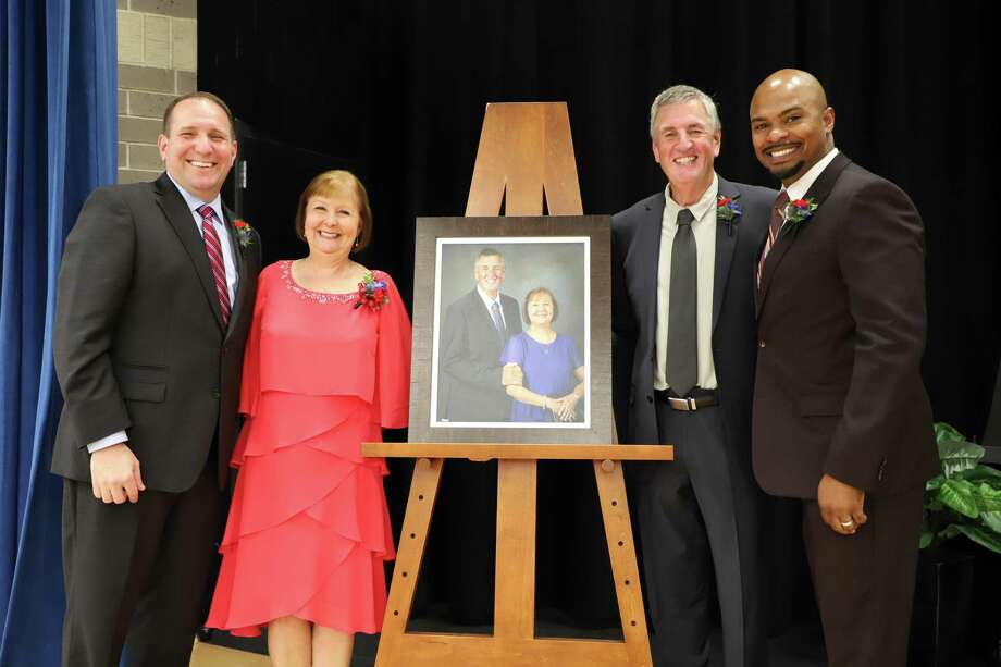 From left to right: CISD superintendent, Dr. Curtis Null; Sheree and David Suchma; and CISD Board of Trustees President Datren Williams stand with the portrait of the Suchmas that will hang in the front hall of the new CISD elementary school named in their honor. Photo: Provided