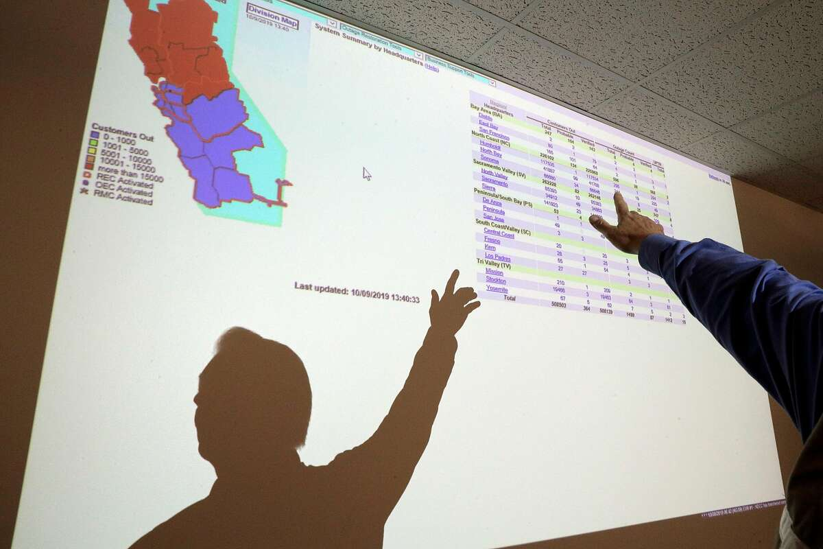 PG&E Communications Representative Mark Mesesan points out current outtages (both PSPS and other) on a screen projection at PG&E's Emergency Operations Center in San Francisco, Calif., on Wednesday, October 9, 2019. The utility's personnel there manage the public safety power shutoffs, which began last night and will continue throughout the day today as the Diablo winds begin to rise.