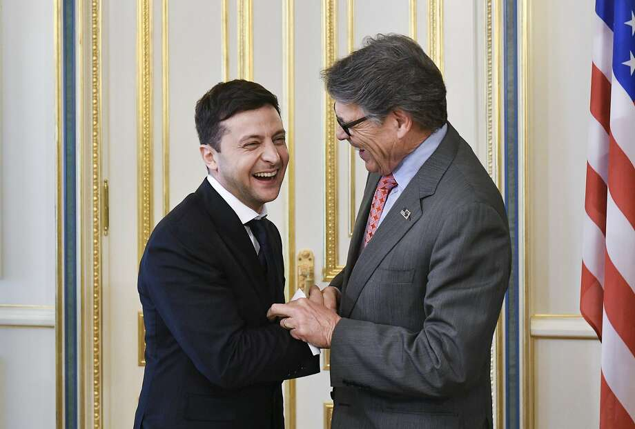 Ukrainian new President Volodymyr Zelenskiy, left, and US Energy Secretary Rick Perry share a joke during their meeting in Kiev, Ukraine, Monday, May 20, 2019. Television star Volodymyr Zelenskiy has been sworn in as Ukraine's next president after he beat the incumbent at the polls last month. (Mykola Lazarenko/Presidential Press Service Pool Photo via AP) Photo: Mykola Lazarenko, AP