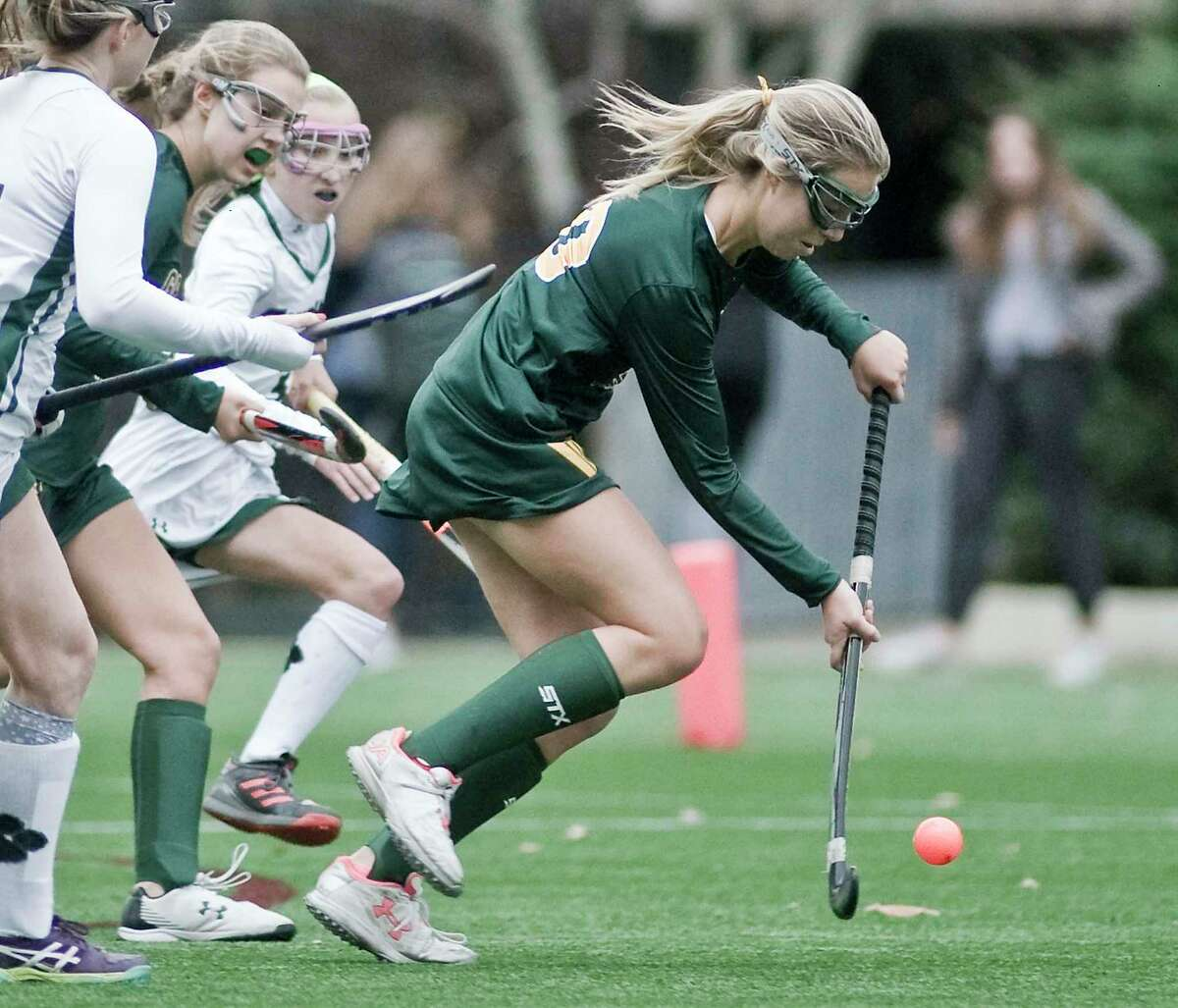 Greenwich Academy's Elektra Rodger moves the ball up the field during a game against Sacred Heart Greenwich last season.