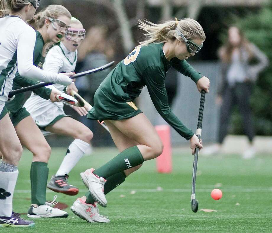 Greenwich Academy's Elektra Rodger moves the ball up the field during a game against Sacred Heart Greenwich last season. Photo: Scott Mullin / For Hearst Connecticut Media / The News-Times Freelance