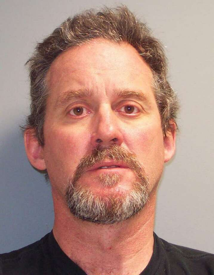 John Tate, 54, a teacher at Brien McMahon High School from Trumbull Conn. was arrested Thursday and charged with second-degree sexual assault for having an inappropriate sexual relationship with a 17-year-old student. Photo: Contributed Photo / ST / Connecticut Post Contributed
