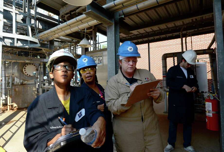 From left, Brandy Bean-Plair, Keyola Arvie, and Maranda Curry confer as they check levels and take readings during their shift in Thomas Day's petrochemical operations working classroom at LIT. The small plant mixes and separates water and propylene glycol, providing hands-on education for students nearing graduation and moving on to find work in the petrochemical industry.   Photo taken Friday, October 04, 2019 Kim Brent/The Enterprise Photo: Kim Brent / The Enterprise / BEN