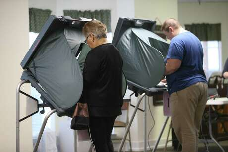 Voters fill out their ballots at a polling station in Houston, Texas.