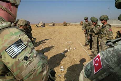U.S. and Turkish troops conduct their third joint ground patrol within a planned safe zone in northern Syria, along the Syrian-Turkish border in Tell Abyad, Syria on Oct. 04, 2019.