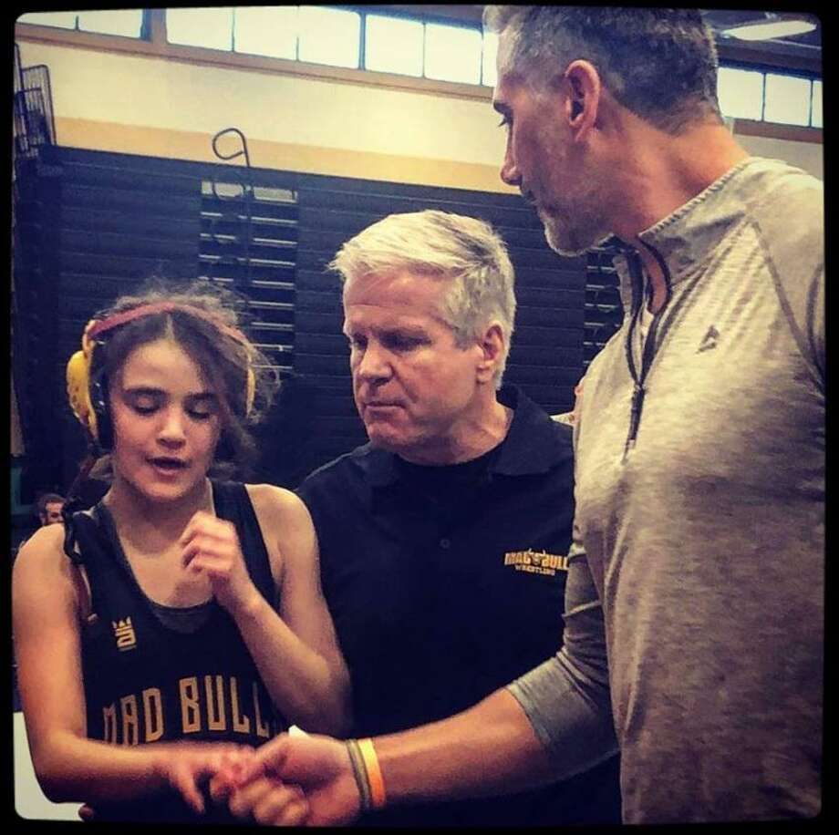 Calli Gilchrist winning a big match with coach Pete Tucci and Art Schad. Photo: Contributed Photo