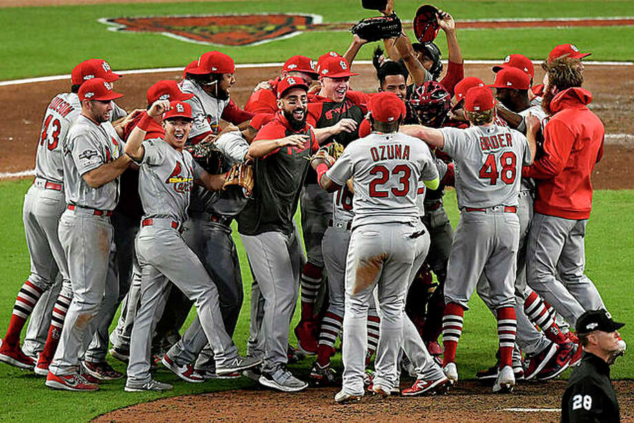 The Cardinals celebrate after beating the Atlanta Braves 13-1 in Game 5 of their National League Division Series Wednesday in Atlanta. Photo: AP Photo