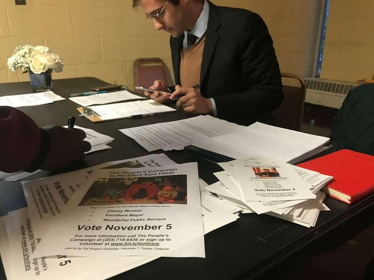 In this file photo and then a Mayor Toni Harp supporter, Alex Taubes collected information to remind voters to vote.