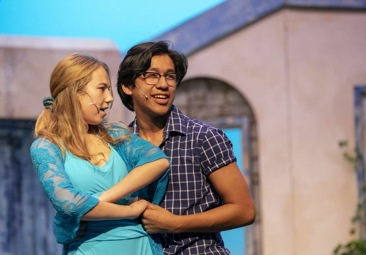 Sarah Filek plays Sophie Sheridan and Gabriel Almager plays sky in 'Mamma Mia' during rehearsals Monday, Oct. 7, 2019 at Midland High School. Jacy Lewis/Reporter-Telegram
