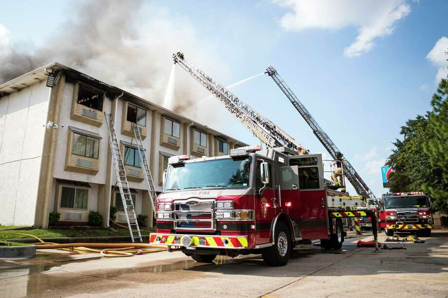 Firefighters from Spring, Ponderosa, Little York, Klein, and The Woodlands Fire Departments battle a multi-alarm fire at the Motel 6 on Cypresswood CT in North Harris County Wednesday, Oct 9, 2019, in Houston. Photo: Joe Buvid, Contributor / © 2019 Joe Buvid