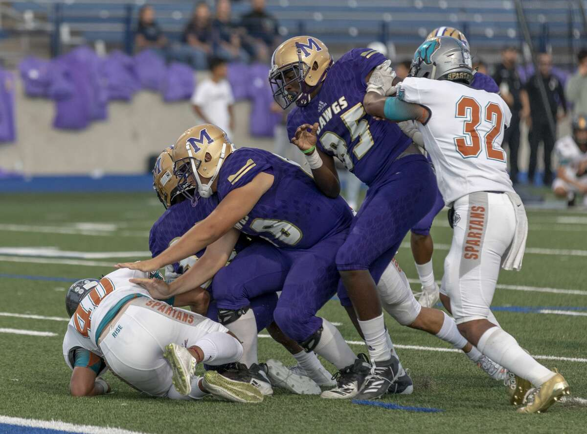 Midland High's Jonathan Cajigal (85) blocks El Paso Pebble Hills' Chaz Celmons (32) from piling on to Midland High's Donovan Valles and Daniel Garcia on Sept. 6, 2019 at Grande Communications Stadium. Photo by Jacy Lewis/Reporter-Telegram
