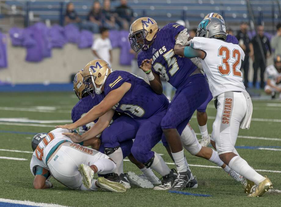 Midland High's Jonathan Cajigal (85) blocks El Paso Pebble Hills' Chaz Celmons (32) from piling on to Midland High's Donovan Valles and Daniel Garcia on Sept. 6, 2019 at Grande Communications Stadium. Photo by Jacy Lewis/Reporter-Telegram Photo: Jacy Lewis/Reporter-Telegram