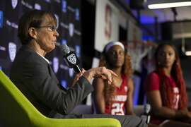 From left to right, Stanford head coach Tara VanDerVeer along with players Kiana Williams and DiJonai Carrington speak to reporters during the Pac-12 Conference women's NCAA college basketball media day Monday, Oct. 7, 2019, in San Francisco. (AP Photo/D. Ross Cameron)