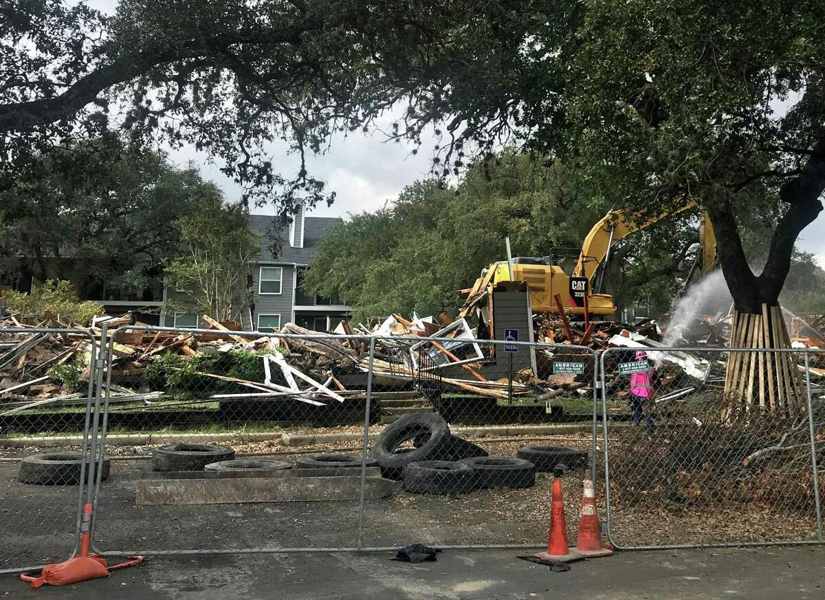 A Hansco demolition crew razed a building Wednesday that was destroyed by a three-alarm fire at Villa Rodriguez Apartments on the Northeast Side last month. Two residents complained they had trouble retrieving their belongings before the building was torn down.