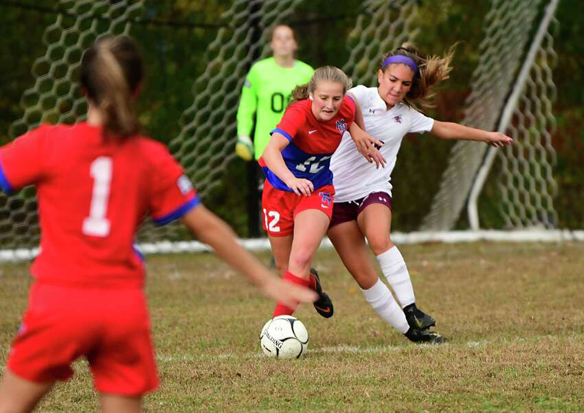 Maple Hill's Alexis Tedford, #12, vies for the ball with Greenville's Bella Trostle during a soccer game on Wednesday Oct. 9, 2019 in Schodack, N.Y. (Lori Van Buren/Times Union)