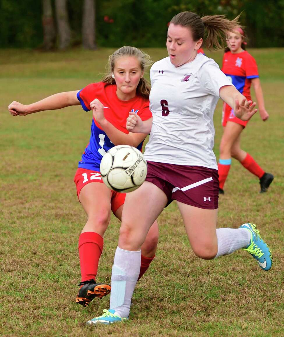 Maple Hill's Alexis Tedford, left, vies for the ball with Greenville's Keili McNerney during a soccer game on Wednesday Oct. 9, 2019 in Schodack, N.Y. (Lori Van Buren/Times Union)