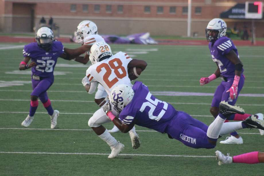 It's not often that Dobie's Dontavion Crosby (28) gets caught at the line of scrimmage as he did on this run attempt last Saturday. The district's second-leading rusher has an opportunity to put a dent in Jacob Henriquez's lead because he and the Eagles have their bye date. Photo: Robert Avery