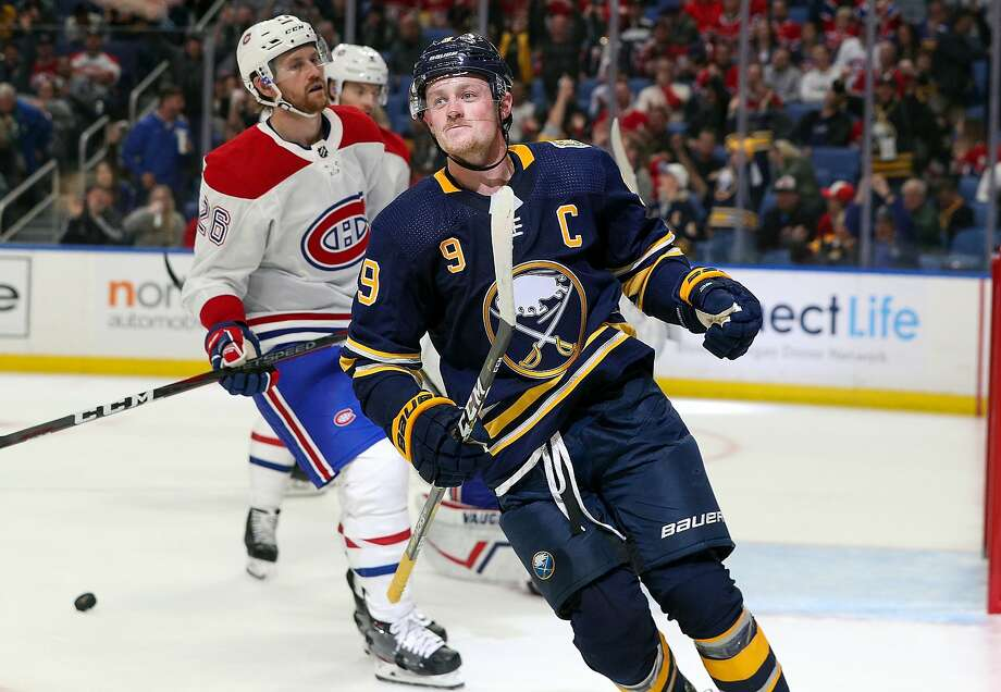 The Sabres' Jack Eichel (9) celebrates after scoring his second goal against the Canadiens. Photo: Nicholas T. LoVerde / Getty Images