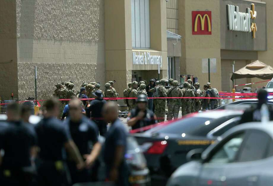 FILE - In this Aug. 3, 2019, file photo, several law enforcement agencies respond to an active shooter at a Walmart in El Paso, Texas. Suspect Patrick Crusius who was indicted for the killing of 22 people in the mass shooting at the Texas Walmart is set to formally hear the charges against him in an El Paso courtroom. An arraignment hearing for Crusius is set for Thursday, Oct. 10. (Mark Lambie/The El Paso Times via AP, File) Photo: Mark Lambie, AP / The El Paso Times