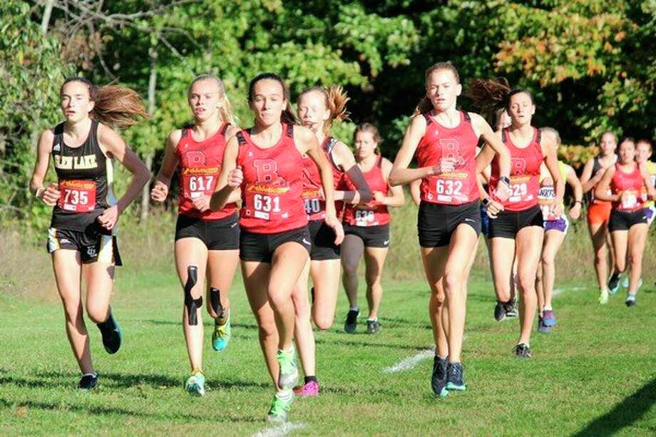 A group of Benzie Central runners get off to a fast start. (Photo/Robert Myers)