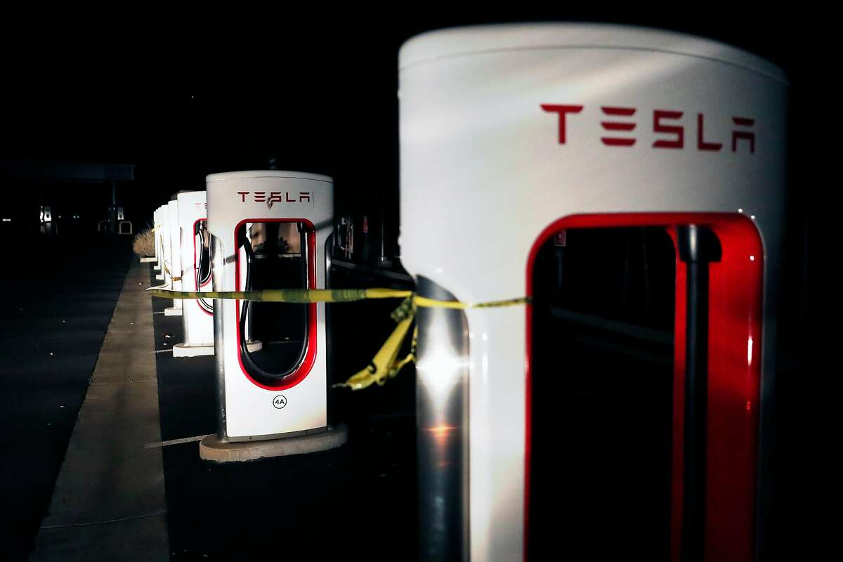A Tesla charging station for electric vehicles is taped off along Devlin Road during the PG&E power shut-off in Napa.