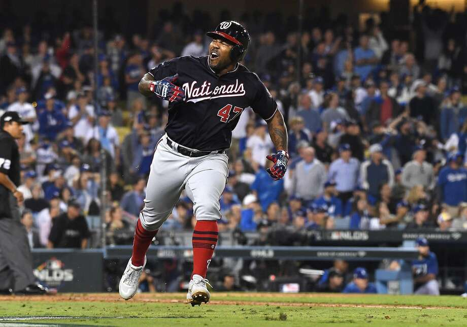 The Washington Nationals' Howie Kendrick celebrates his grand slam against the Los Angeles Dodgers in the 10th inning during Game 5 of the National League Division Series at Dodger Stadium in Los Angeles on Wednesday, Oct. 9, 2019. (Wally Skalij/Los Angeles Times/TNS) Photo: Wally Skalij, TNS