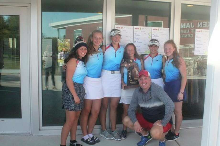 The Big Rapids girl golf team celebrated their regional championship on Wednesday at Katke Golf Course: from left, Kiali Stout, Holly McKenna, Hope Thebo, Lauren Posey, Avery Chaput, Chloe Miller and (in front) coach Mark Posey. (Courtesy photo)