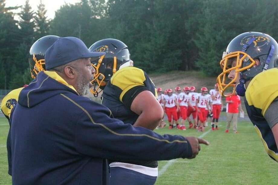 Baldwin football coach Bob Watkins talks with his players; (Star file photo)