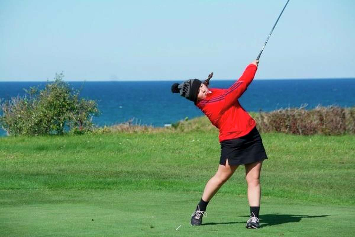 Gigi Green tee off next to Lake Michigan on hole 3 for Big Rapids during Monday golf action. (Courtesy photo)