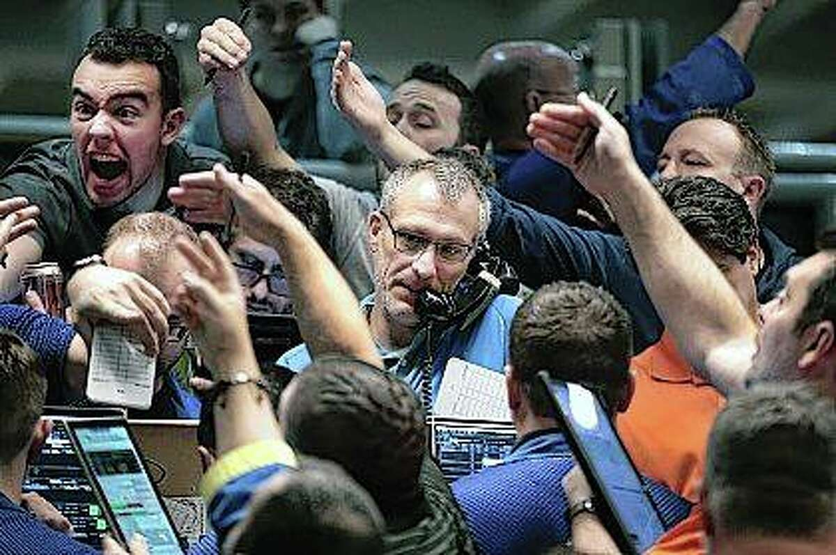 Traders signal offers in the S&P options pit on the Cboe Global Markets trading floor in Chicago on Wednesday.