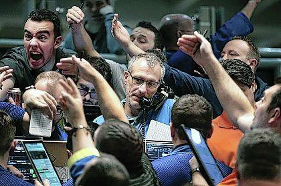 Traders signal offers in the S&P options pit on the Cboe Global Markets trading floor in Chicago on Wednesday. Photo: Scott Olson | Getty Images