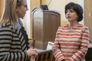 Texas Railroad Commissioner Christi Craddick talks with Celeste Dale Wednesday before speaking at the Women's Energy Network luncheon.