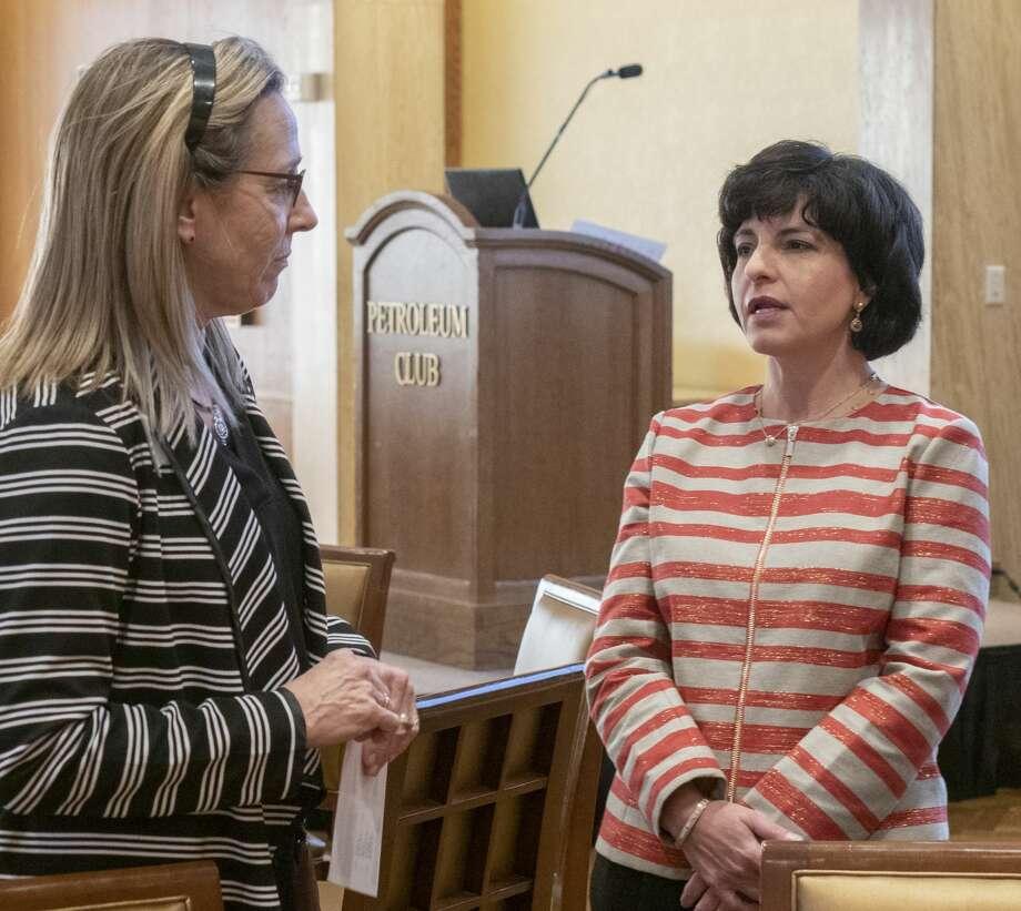 Texas Railroad Commissioner Christi Craddick talks with Celeste Dale Wednesday before speaking at the Women's Energy Network luncheon. Photo: Tim Fischer/Reporter-Telegram / Midland Reporter-Telegram