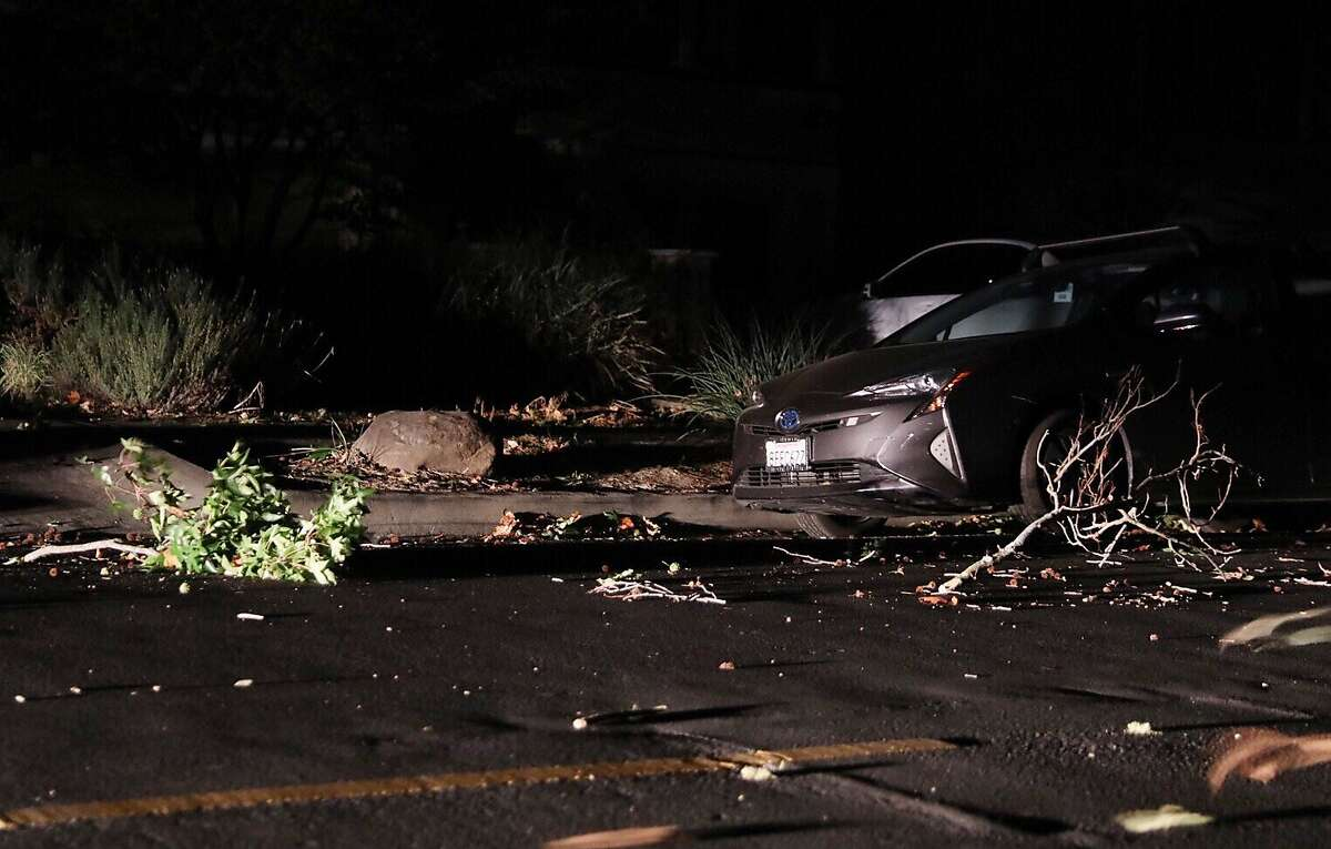 Leaves and branches lie along Coombs Street after being knocked down by high winds in completely dark neighborhood of Napa Abajo Napa, Calif. Thursday, October 10, 2019 during a PG&E Public Safety Power Shutoff.