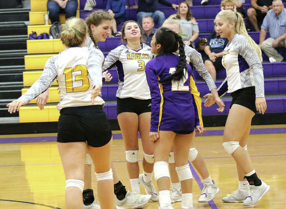 The CM Eagles, shown celebrating a three-set victory over Jersey on Oct. 1, posted another three-set win Wednesday night against Marquette Catholic in Bethalto. Photo: Greg Shashack / The Telegraph