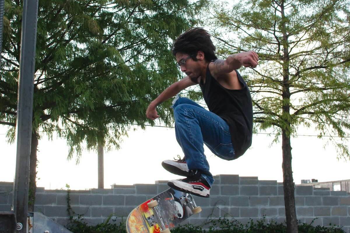 Eddy Diaz performs a skateboard trick at the skate park in Pasadena Memorial Park.
