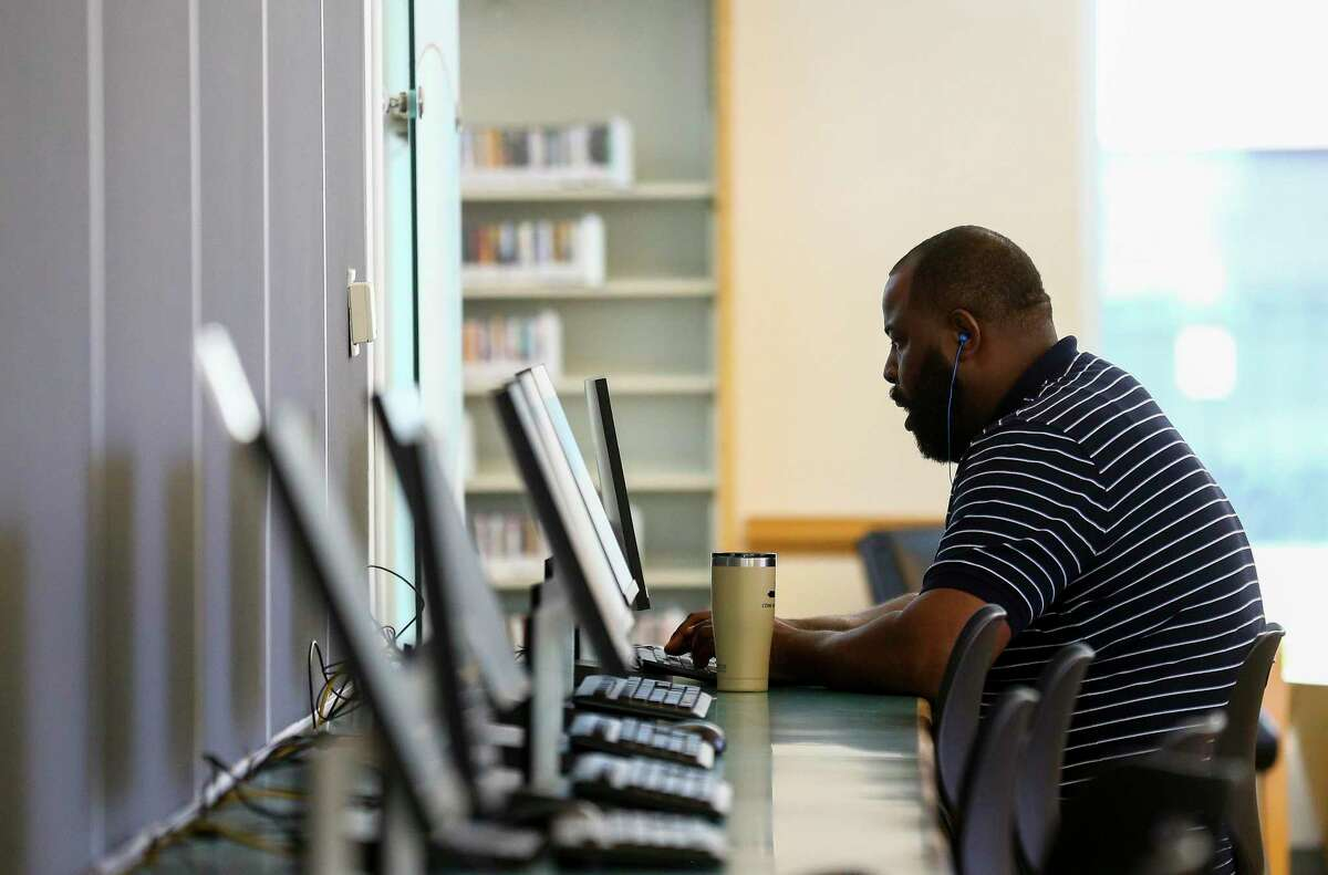 Lionel Garr uses a computer at the McGovern-Stella Link Library Tuesday, Oct. 1, 2019, in Houston. Two years ago, this library was one of 12 library branches in Houston and Harris County to close due to water damage from Hurricane Harvey.