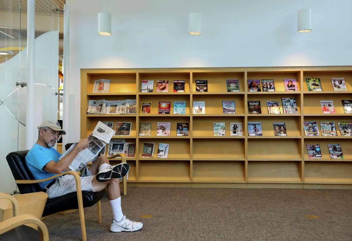 Select libraries are now open. Just be sure to wear a mask, not like in this pre-pandemic photo from 2019.